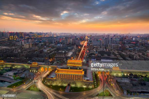 Aerial view of illuminated Xian north gate of city wall and road with light trails, Xian, Shaanxi, China