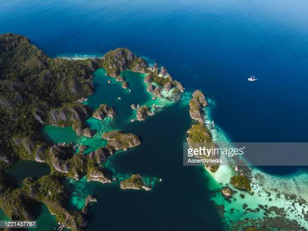 aerial view of indonesian island archipelago - archipelago stock pictures, royalty-free photos & images