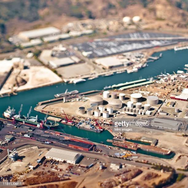 aerial view of industrial area and seaport - industriegebiet stock-fotos und bilder