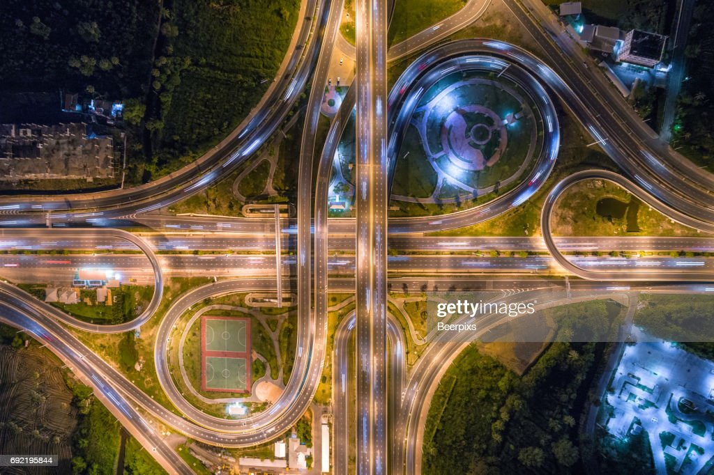 Aerial view of infinity road intersection at night. : Stock Photo