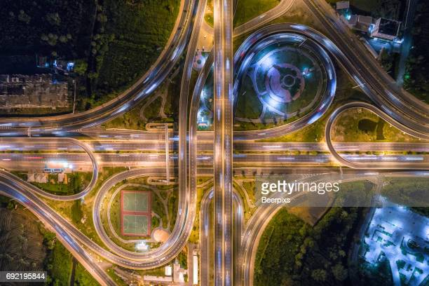 Aerial view of infinity road intersection at night.