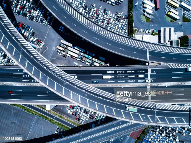aerial view of intersection and crowded car slots - 俯瞰 ストックフォトと画像