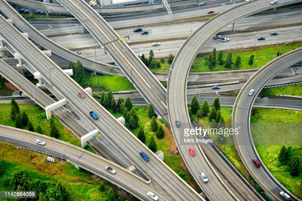 aerial view of interstate change overpasses - integrated stock pictures, royalty-free photos & images