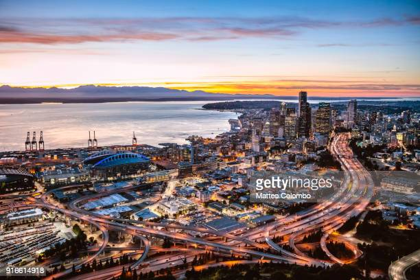 Aerial view of Interstate highway and Seattle downtown at sunset