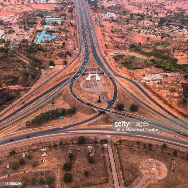 aerial view of intertwined highways - abuja stock pictures, royalty-free photos & images