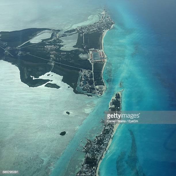 aerial view of island and sea - bimini stock photos and pictures