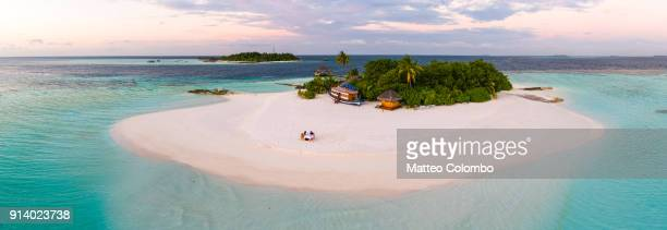 Aerial view of island at sunset, Maldives