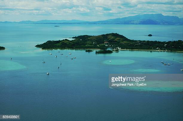 Aerial View Of Island In Blue Sea