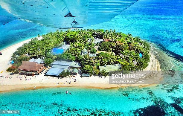 Aerial View Of Island Seen Through Airplane
