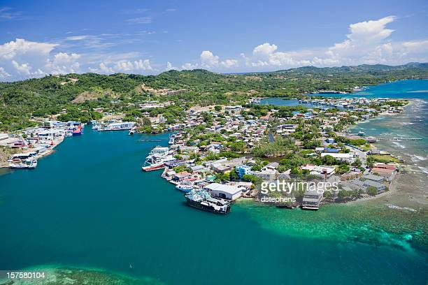 aerial view of island village - honduras stock pictures, royalty-free photos & images