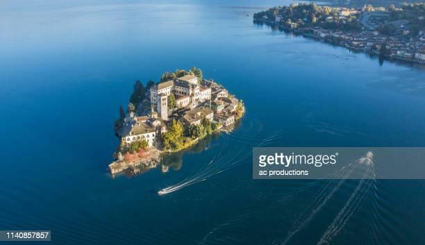 aerial view of isola san giulio on lake maggiore, italy - europa locais geográficos - fotografias e filmes do acervo