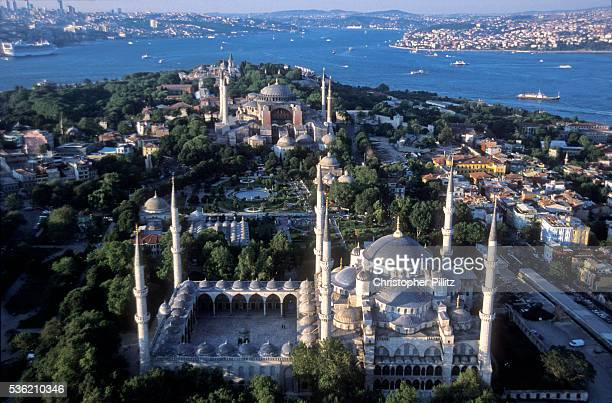 Aerial view of Istanbul city scape with the Blue Mosque in the foreground and thr Hagia Sophie in the background with a clear view of the Bosphorous...