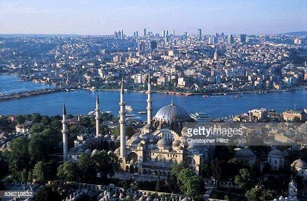 Aerial view of Istanbul city scape, with the Suleymanie Mosque in foreground, the Golden Horn and modern Istanbul in the background, Turkey.