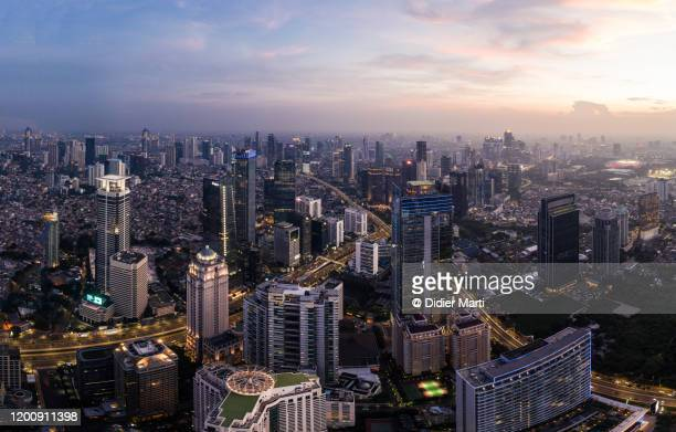 aerial view of jakarta business district in indonesia capital city - indonesia stock pictures, royalty-free photos & images