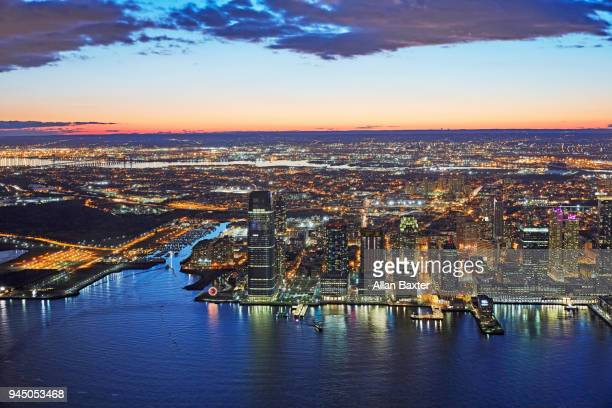 aerial view of jersey city and new jersey at twilight - newark new jersey stock photos and pictures