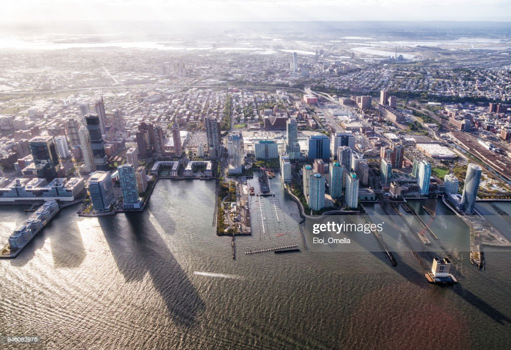 aerial view of Jersey City in front of Hudson river : Stock Photo