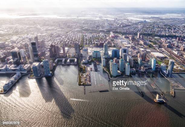 aerial view of Jersey City in front of Hudson river