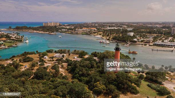 aerial view of jupiter lighthouse in jupiter, florida at mid-day during spring break in march of 2021 - jupiter florida stock pictures, royalty-free photos & images