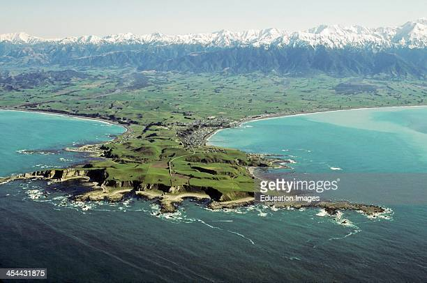 Aerial view of Kaikoura Peninsula and town from the eaSt Note successive marine terraces uplift wave cut platforms Snow clad seaward Kaikoura...