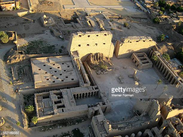 Aerial view of Karnak showing the 1st Pylon the forecourt and the 2nd Pylon The temple of Ramses III can be seen at the bottom left and the small...