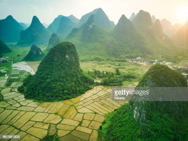 aerial view of karst mountains and rice fields near guilin, yangshuo - country geographic area stock pictures, royalty-free photos & images