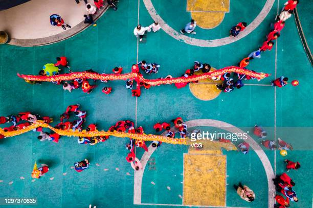 Aerial view of kindergarten children performing dragon dance to celebrate the Laba Festival on January 20, 2021 in Xiangxi Tujia and Miao Autonomous...