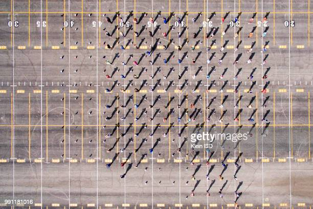 aerial view of klein high school marching band practising, texas, north america. - marching band stock pictures, royalty-free photos & images