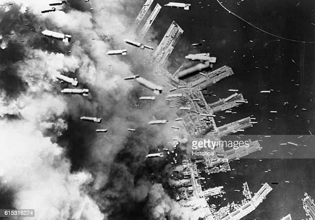 Aerial view of Kobe docks during an air raid using 500 B29 bombers Smoke obscures most of the city with more bombs falling