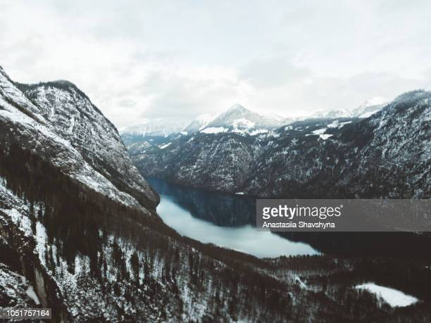 aerial view of konigsee lake and winter snowy bavarian alps peaks - königssee bavaria stock photos and pictures