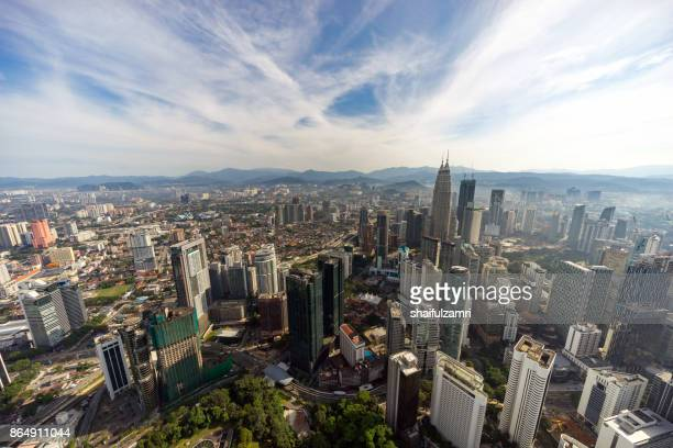 aerial view of kuala lumpur with petronas twin towers (451.9 metres), inspired by tun mahathir mohamad's vision for malaysia to be a global player. - shaifulzamri imagens e fotografias de stock