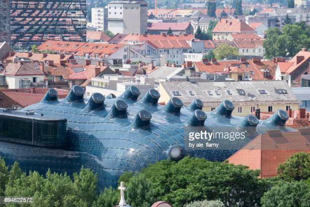 aerial view of kunsthaus, graz art museum from schlossberg hill, graz, styria, austria - graz stock photos and pictures