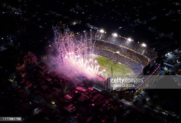 TOPSHOT Aerial view of La Bombonera stadium in Buenos Aires taken as fireworks welcome the teams into the pitch before the allArgentine Copa...