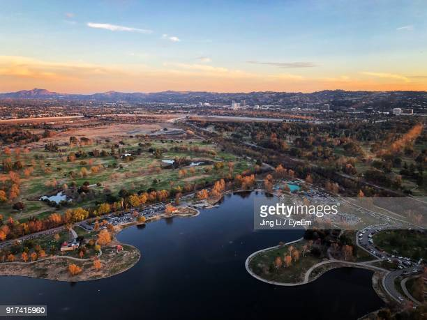 Aerial View Of Lake Against Sky During Sunset