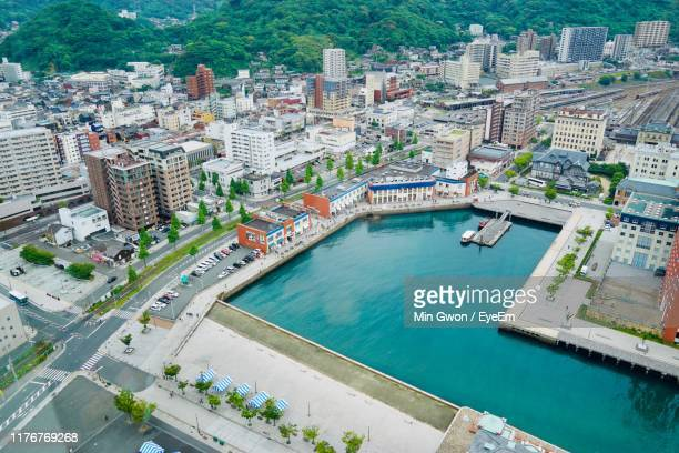 aerial view of lake amidst buildings - fukuoka prefecture stock pictures, royalty-free photos & images