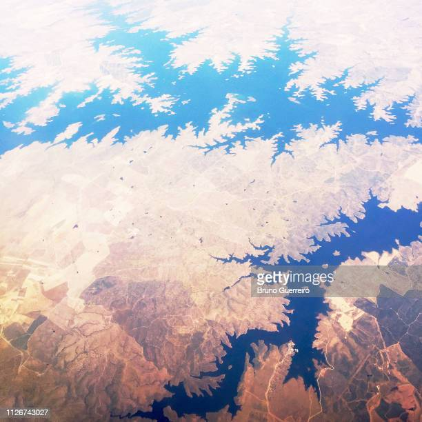 aerial view of lake among dry landscape - faro city portugal stock photos and pictures