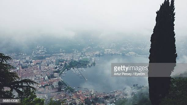 aerial view of lake and houses in town - artur petsey foto e immagini stock