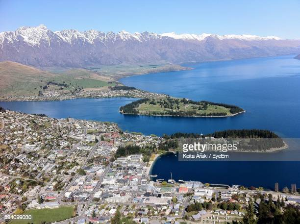 Aerial View Of Lake And Mountains Against Clear Sky