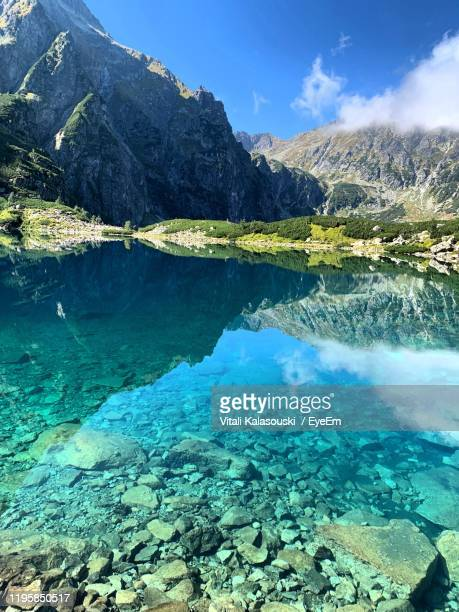 aerial view of lake and mountains against sky - zakopane stock pictures, royalty-free photos & images