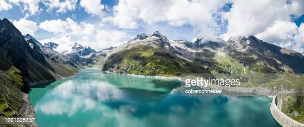 aerial view of lake mooserboden and dam wall, kaprun high mountain reservoirs, salzburg, austria - stausee stock-fotos und bilder