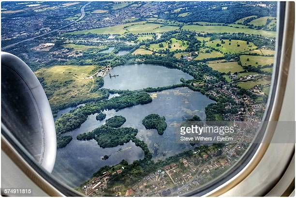 Aerial View Of Lake Seen Through Airplane Window