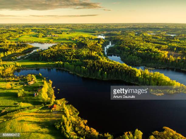 aerial view of lake stupens and green forests - latvia stock pictures, royalty-free photos & images