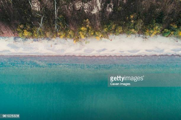 aerial view of lake superior by trees in forest - lake superior stock pictures, royalty-free photos & images