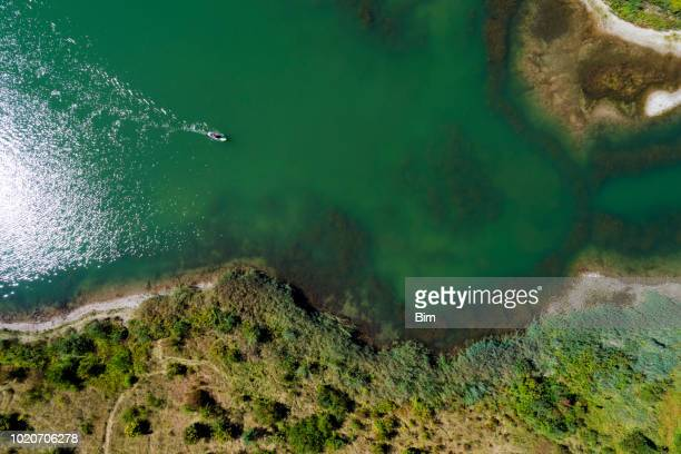Aerial view of lake with man on paddleboard