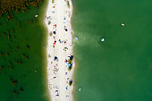 aerial view lake with people beach