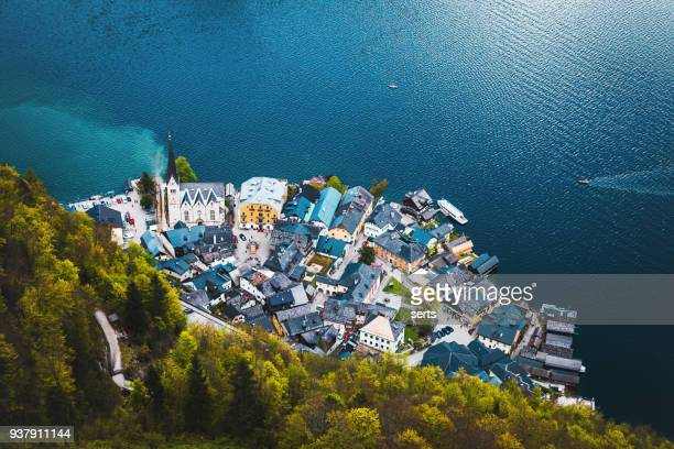 aerial view of lakeside village of hallstatt in austria - austria stock pictures, royalty-free photos & images