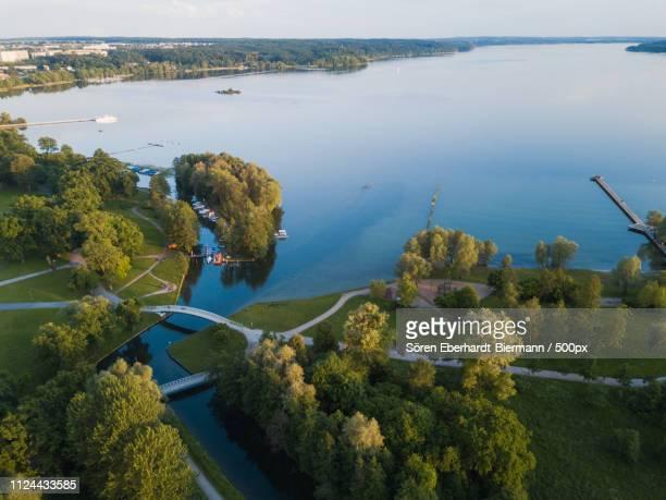 aerial view of land - riva del lago foto e immagini stock