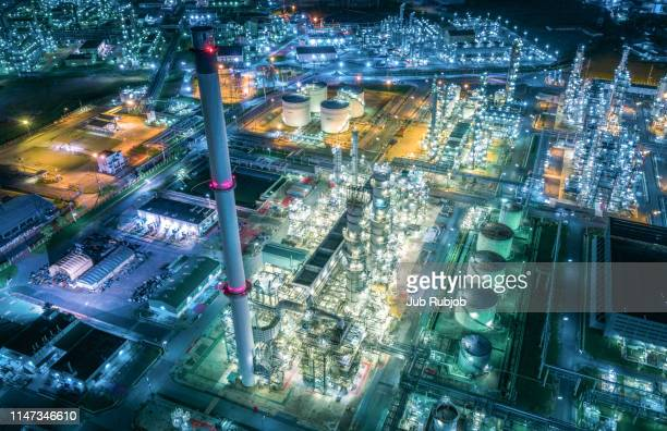 aerial view of land scape of oil refinery plant at twilight time - complexity stock pictures, royalty-free photos & images