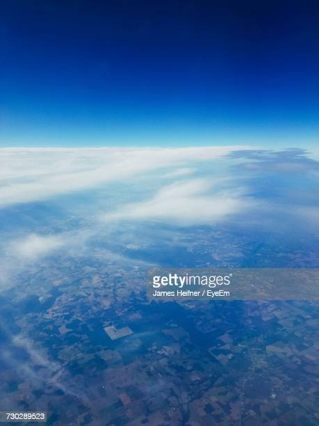 Aerial View Of Landscape Against Blue Sky