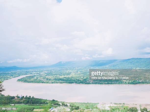 Aerial View Of Landscape Against Cloudy Sky