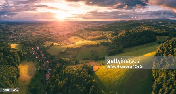 aerial view of landscape against sky during sunset - dämmerung stock-fotos und bilder